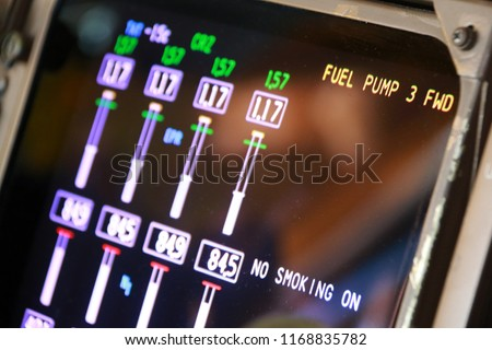 Close up on the Engine Indication and Crew Alerting System in the Cockpit of a Jumbo Jet