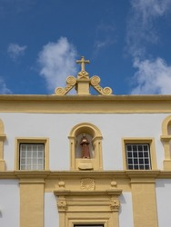 Close up on the façade of the Franciscan Convent of São Boaventura, which now houses the Museum of Flowers. With a blue sky in the background. Santa Cruz das Flores, Flores Island.