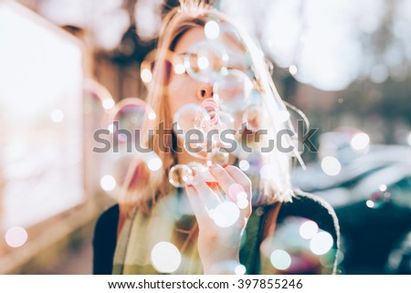 Close up on the hand of young beautiful woman blowing bubble soap - ethereal, joy, happiness concept Stock foto ©