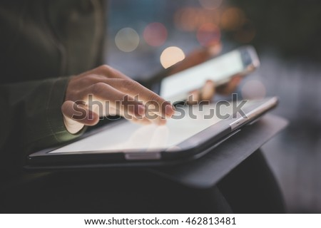 Close up on the hand of young handsome caucasian woman pointing and touching the screen of a tablet with her finger - technology, social network, communication concept #462813481