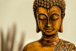 Close up on the head of Buddha statue with serene smile