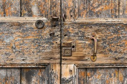 Close up on the lock and handle of an old door.