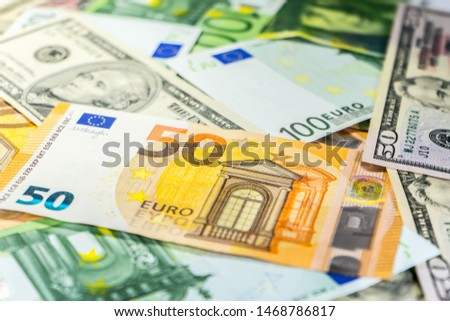 Close up on various Euro USD Dollars and CHF banknotes on the table business and finance money wealth savings credit finance