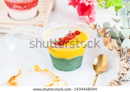 Close up on vegan Trifle dessert made with fruit mango spirulina. English cuisine. Close up horizontal food photo. Gluten free, healthy dessert. Vegan food and sweets. Snack. Copy space #1434468044
