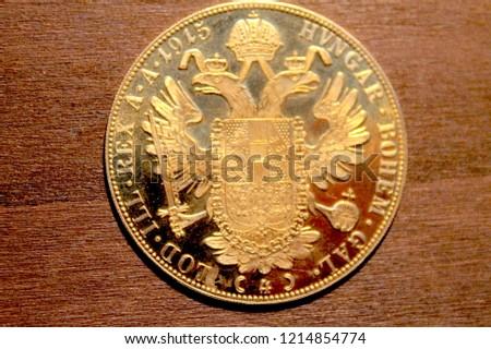 Close Up on Wood, Austria-Hungary thalers, back of golden coin-ducat, 1915, Kaiser Franz Joseph I,