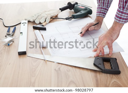 Close-up on worker looking into a house plan