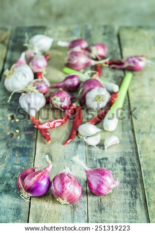 Close up onions,garlic,dry pepper and lemon grass on wooden table