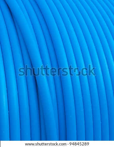 close-up op blue cable on a cable drum