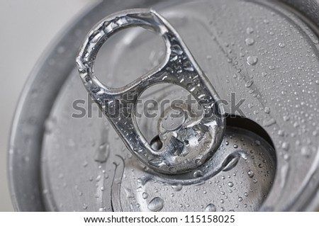 Close-Up open aluminum can with water drops