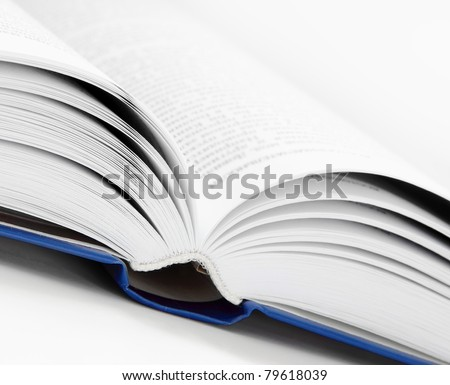 Close Up Open Book in White and Blue