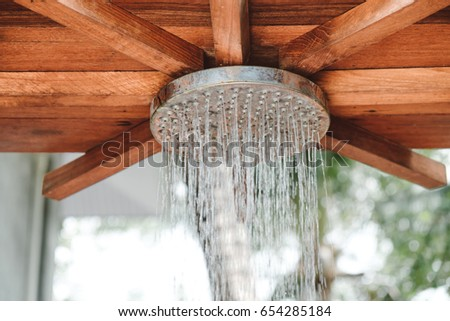 close up open outdoor rain shower at swimming pool