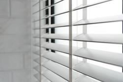 Close-up open venetian blinds. lighting range control sunlight coming from a window. decoration interior. Modern jalousie.