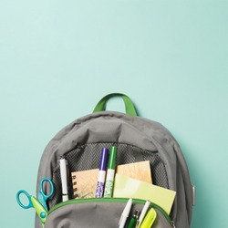 Close up opened backpack with school accessories