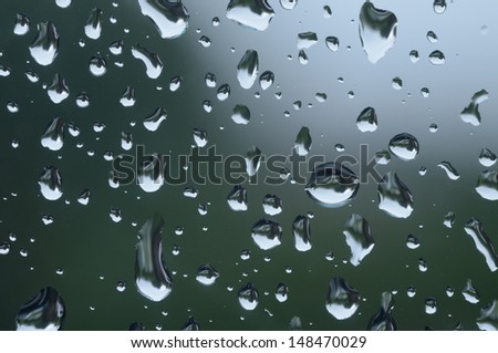 Close up or Macro image of rain drops on a window during a rain storm.