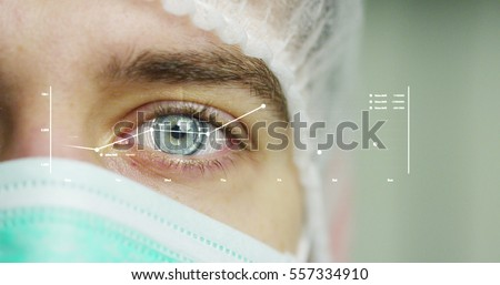 close up or macro of an eye of a doctor, surgeon. futuristic and technological vision of medical care and patient protection. futuristic medicine, technology Eye, medical holography, future #557334910