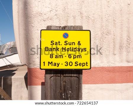 close up orange parking sign outside sunny day ; essex; england; UK