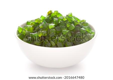Close-up Organic green tutti frutti sweet soft candy  in white ceramic  bowl on white background Foto d'archivio ©