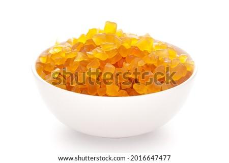 Close-up Organic yellow tutti frutti sweet soft candy  in white ceramic  bowl on white background Foto d'archivio ©