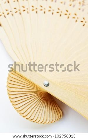 Close up oriental wooden fan pattern