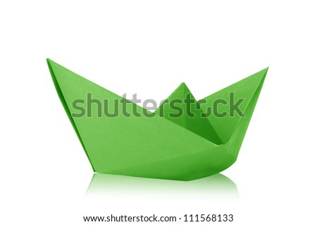 Close up origami green paper ship on white background.