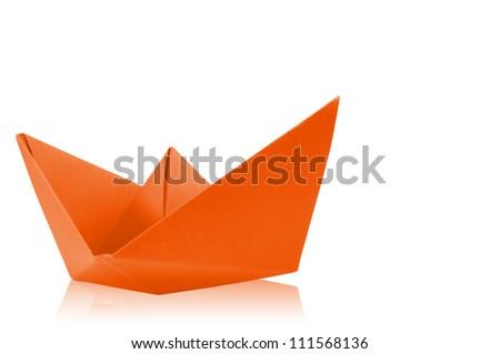 Close up origami orange paper ship on white background.