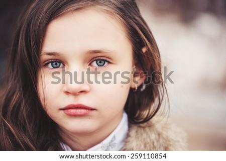 close up outdoor portrait of adorable caucasian child girl