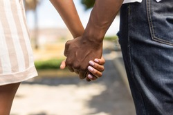 Close up outdoor protrait of black african american couple holding hands