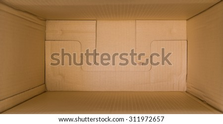 close up packed or hidden inside a cardboard packaging box