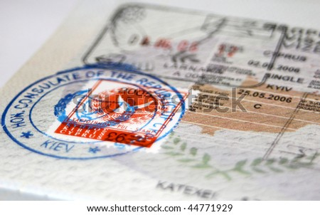 Close-up page of passport with Cyprus visa and stamps