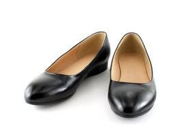 close up pair of black women shoes (low-heeled) isolated on white background, flat shoes simple and formal style for women