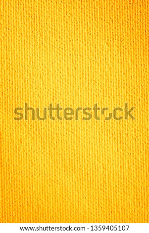 Close up paper texture background. Abstract seamless yellow pattern. Goya Canvas.