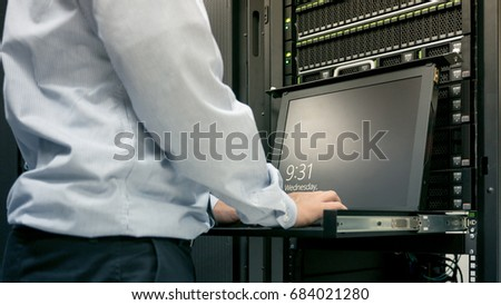 Close up part of administrator working in data center #684021280