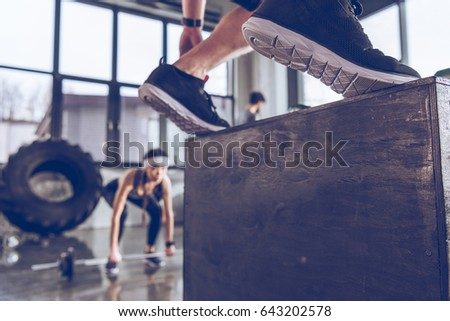 Close-up partial view of sporty people exercising at cross fit gym workout   #643202578