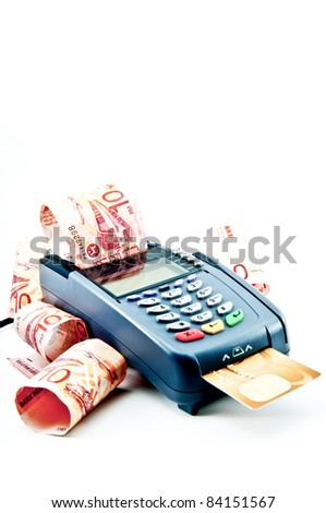 Close up Payment machine on during using Credit card from customer in shopping mall