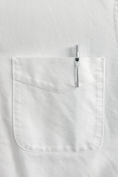 Close up pen in pocket on white shirt