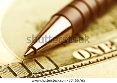 close-up pen on the money with shallow DOF