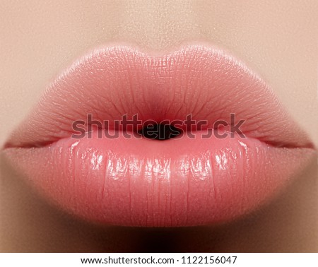 Close-up perfect natural lip makeup beautiful female mouth. Plump sexy full lips. Macro photo face detail. Perfect clean skin, fresh lip make-up. Beautiful spa tender lips