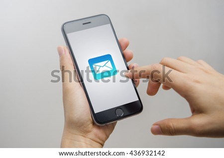 Close Up Person hand and Mobile Phone with email icon, Email concept.