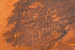 Close-up petroglyphs etched on rock wall, Valley of Fire State Park, Nevada, USA