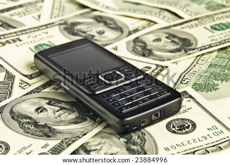 close up phone on the money background