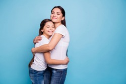 Close up photo adorable amazing pretty two people brown haired mum small little daughter stand close eyes closed holding hands arms circle wearing white t-shirts isolated on bright blue background
