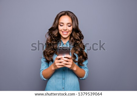 Close up photo amazing beautiful her she lady hold arms hands smart phone reading news check likes followers group contact people wearing casual jeans denim shirt clothes isolated grey background #1379539064
