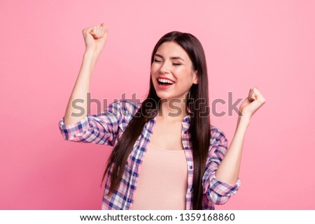 Close up photo amazing beautiful her she lady hold both arms hands raised up party festive mood celebrating holiday amused wear casual checkered plaid shirt clothes outfit isolated pink background #1359168860