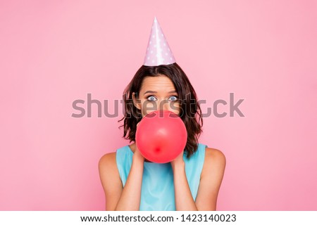 Close up photo amazing beautiful she her lady attractive appearance birthday cap head hide half face big red balloon blowing air staring wear shiny colorful blue dress isolated pink bright background Сток-фото ©