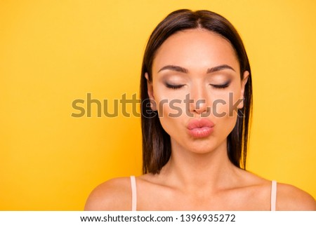 Close up photo amazing beautiful she her lady send air kisses boyfriend show ideal tempting big operated lips mouth wear casual pastel tank-top outfit clothes isolated yellow bright background