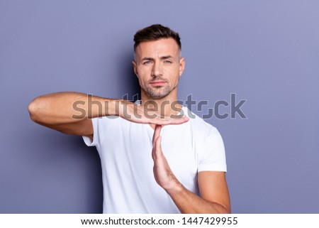 Close up photo amazing he him his middle age macho hand palm arm raised air time out sport  symbol you will not pass through facial expression strict wear casual white t-shirt isolated grey background #1447429955