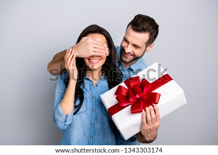 Close up photo amazing she her he him his lady guy hide eyes guess who game prepared romance surprise hold big large giftbox wear casual jeans denim shirts outfit clothes isolated grey background