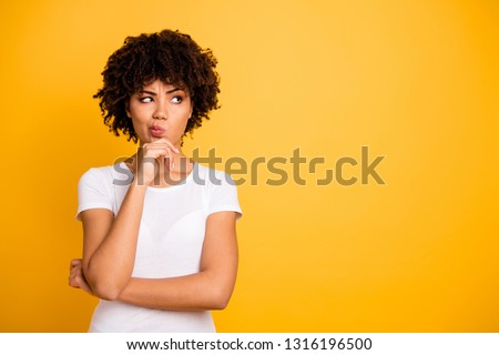 Close up photo beautiful amazed she her dark skin lady arms hands chin think over not sure homework diligent student look empty space wearing casual white t-shirt isolated yellow bright background