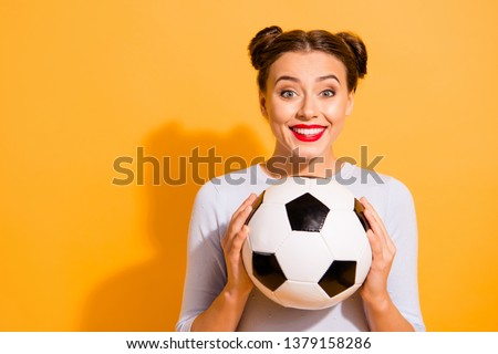 Close up photo beautiful amazing hairdo she her lady hold hands arms leather round ball captain cheerleader pray for win favorite team wearing casual white pullover isolated yellow background