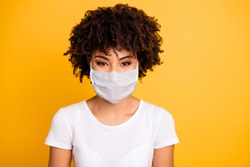 Close up photo beautiful amazing she her dark skin lady optimistic save covid-19 infection wear medical mask casual white t-shirt isolated yellow bright vibrant vivid background